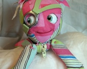 Pink adveturer movable eyes zipper tummy goggle girl feed sack baby by Karen Knapp of Tindle Bears