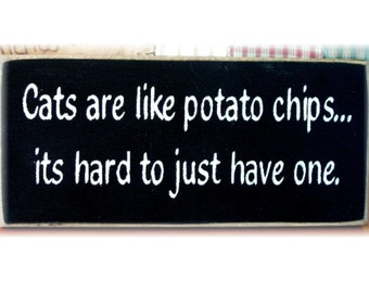 Cats are like potato chips... its hard to just have one primitive wood sign