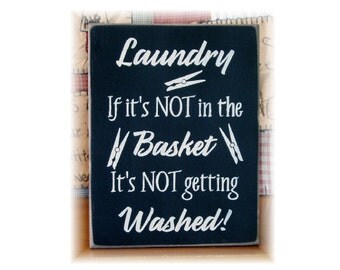 Laundry if it's not in the basket it's not getting washed wood sign