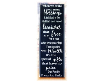 When we count our many blessings... vertical family typography wood sign