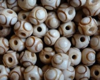 Carved bone rounds
