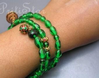 Bracelet . Enamel. Emerald green .glass Crystals .Dangle .Charm .Coil Wrap Bracelet Bangle