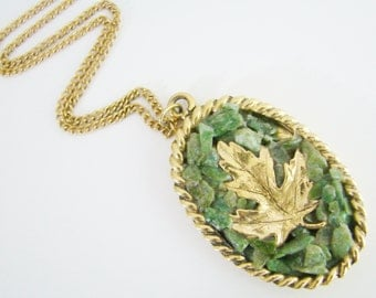Vintage long gold necklace with jade green gemstone leaf pendant (N25)