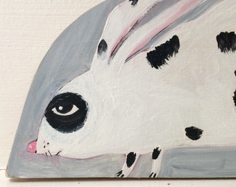 Original painting on reclaimed wood of a black and white pet bunny rabbit
