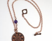 Etched copper sun necklace with amethyst bead