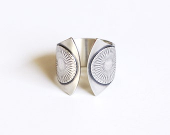 "Wide band silver ring with a sun solar motif and a dual fluted shape with twin patterned circles at the curved open ends - ""Helios Ring"""