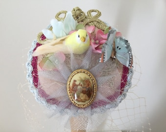 Bird fascinator, yellow and pink butterfly veil hat.