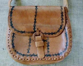 leather detailed bohemian shoulder cross bag with black imprints
