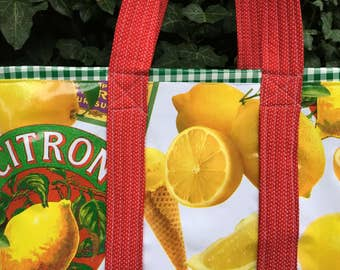 French cafe oilcloth tote bag with lemons and lemon macaroons and ice cream