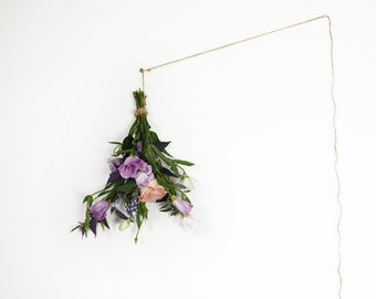 Modern Still Life of a bouquet hanging on a white wall