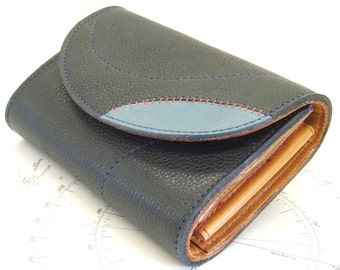 Navy blue leather purse with tan inner and modernist lining