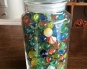 Large jar of marbles vintage 70's era. Mainly cat eyes.