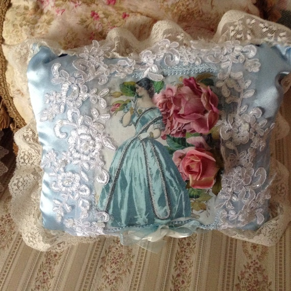 Throw pillow with image of a Victorian lady in a ball dress