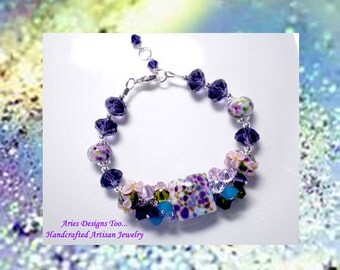 Bejeweled...Lampwork Bracelet in Purple, Pink, Green and Blue with Floral Accents