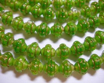 33 6x7mm Czech Glass Green Silk with Gold Saturn Saucer Beads