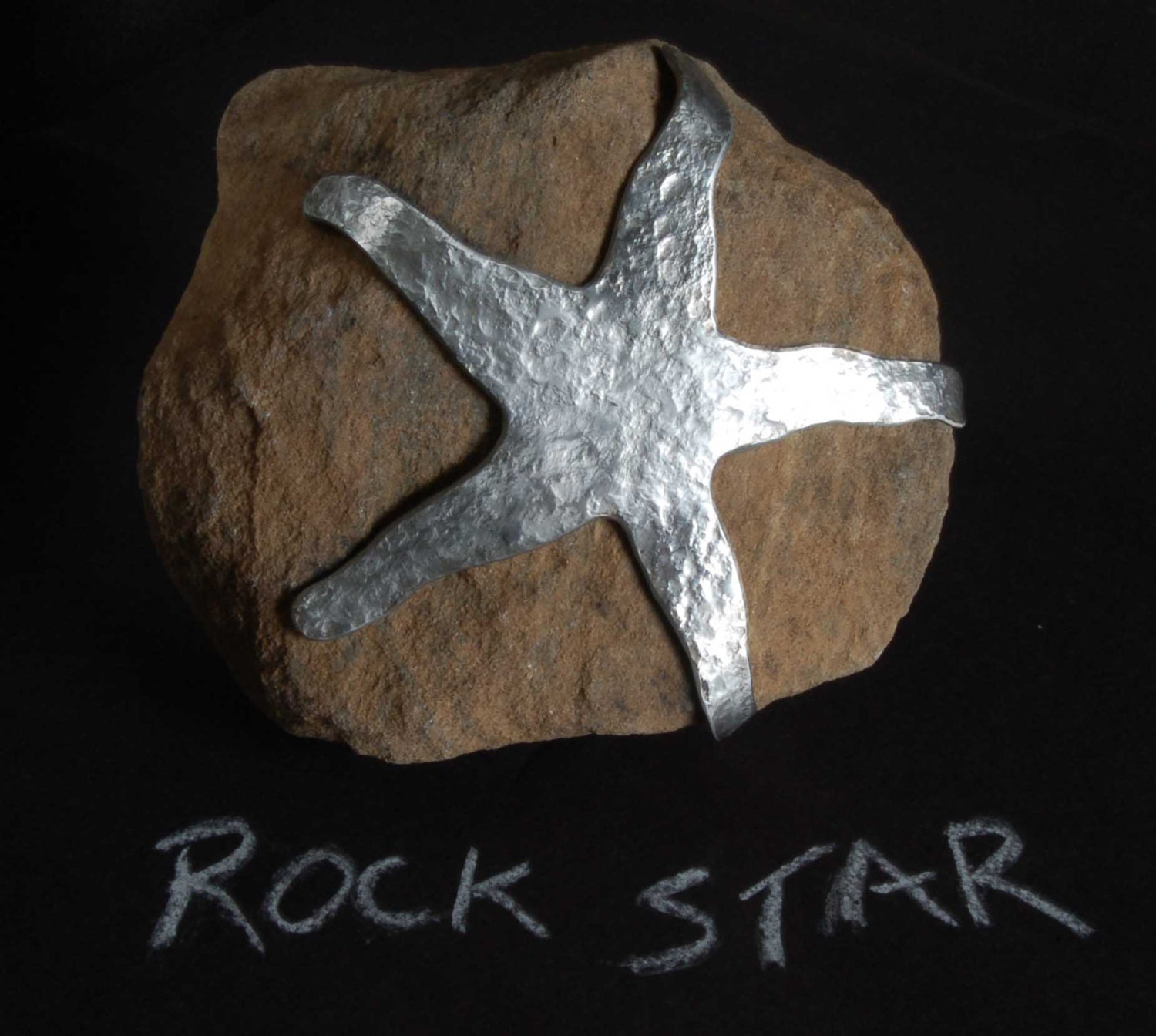Canadian rock star garden decor rock hand forged stainless for Garden accessories canada