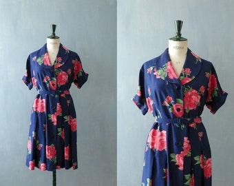Vintage 1950s dress. 50s shirtwaist dress. floral print dress