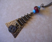 Mixed Metal Pagoda and Chinese Coin Necklace with Glass Lampwork Accent Bead