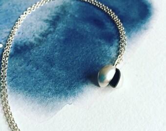 Silver split pod necklace
