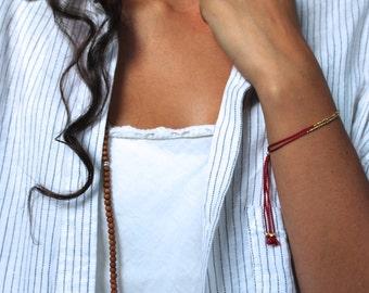 Gold beaded bracelet,  gold bracelet with beads, gold hammered beads, simple gold bracelet, red silk gold beaded bracelet tiny gold bracelet