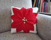 small decorative white burlap pillow with flower from vintage wool and buttons