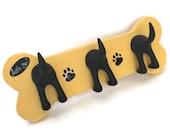 Triple tail dog leash holder on hand-made wooden bone.