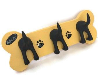 Triple tail dog leash holder on hand-made wooden bone.