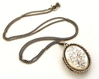 Vintage oval sterling silver locket and chain , rose design