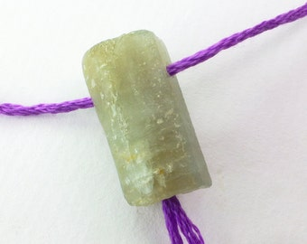 Natural aquamarine gemstone crystal guru bead. Drilled for making mala meditation beads with tassels. 1 pc. 21 cts. 11x21x9 mm (EM2360)
