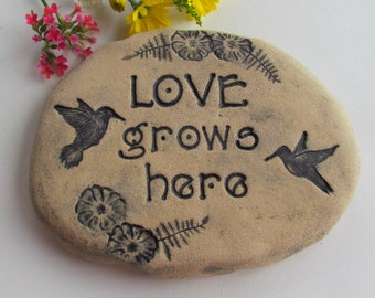 "Hummingbird garden decoration. stone with saying / Words ""Love grows here"". Sculpted clay garden art, ceramic art tile"
