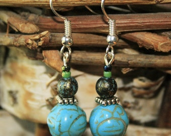 Carved turquoise-colored beaded earrings