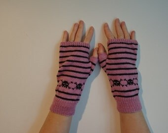 Pink fingerless gloves with black stripes and band of skulls and crossbones, wool blend sock yarn, adult size small/medium