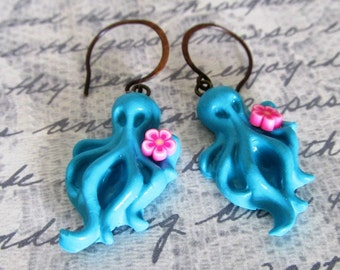 Super cute Octopus earrings Aqua blue with a pink flower on antique copper ear wires made from clay