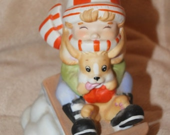 """1987 Enesco """"Whee!"""" Winter Boy & Dog On Sled Figurine Stanley Collection Gallery Four Seasons Of Childhood"""