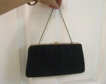 Black taffeta clutch bag with gold chain and snap