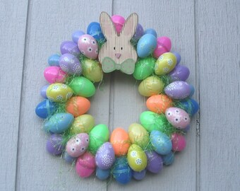 Fun Colorful Easter wreath! Filled with decorated Easter Eggs, Green Grass and a Bunny on top.