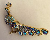 "Pretty Peacock Brooch Completes an Outfit, Purse, Tote, Scarf, Hat or Bridal Bouquet 2"" x 1 1/2"" Shiny Crystals, Blue, Purple"