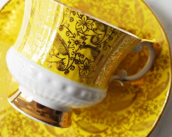 Elizabethan Teacup and Saucer, Yellow and White Floral
