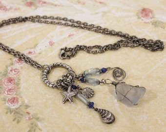 """Interesting Long Nautical Theme Necklace With Several Charms and a """"Stone"""""""
