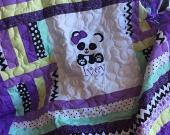 Black, white, purple, and green panda bear baby girl quilt approx. 50x54