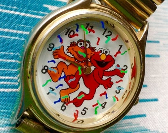 Elmo and Zoe Sesame Street watch vintage rotating animated watch