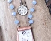 French dancer image with clay , pale blue crystal beads, and watchface.