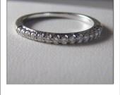 HOLDING --Estate 14k 14 Diamond Wedding Band