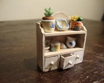 miniature dollhouse shelf with drawer