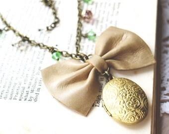 Leather bow necklace. Swarovski beads. Golden locket. Genuine leather bow pendant. Multicolored glass beads. Bohochic