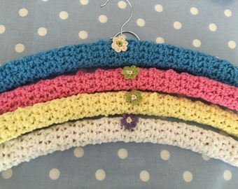 4 large crochet   covered hangers with pretty little crochet flowers