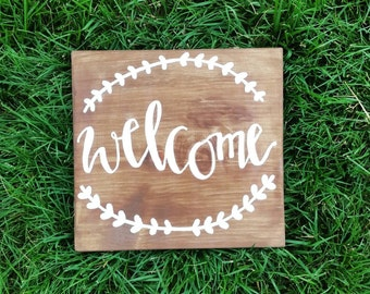 Rustic brown and white welcome sign