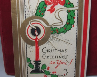 Vintage art deco gold gilded 1930's parchment paper christmas card colorful deco designs of candle holly berry and wreath
