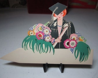 Art Deco die cut 1920's colorful Chas S. Clark place card deco girl in cap and gown with diploma stylized deco flowers, graduation party