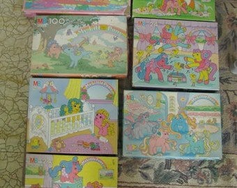 7 Vintage My Little Pony puzzles and a std. faded pillowcase